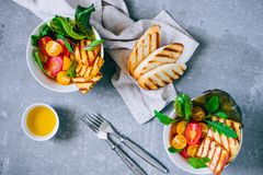 Cherry tomato salad with grilled haloumi cheese, with chard and royalty free stock images