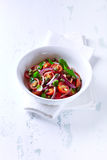 Cherry Tomato Salad with Pine Nuts and Capers Stock Photography