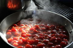Cherry Tomato Sauce. Fresh summer cherry tomatoes are sauteed to make a delicious pasta sauce Stock Photo