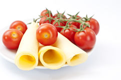 Cherry tomato with sliced cheese Royalty Free Stock Photos