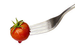 Cherry tomato spiked by a fork Stock Images