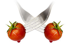 Cherry tomato spiked by a fork with reflection Royalty Free Stock Images