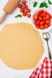 Cherry tomato tart. Cooking process. Royalty Free Stock Image
