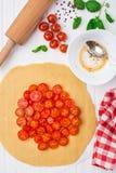 Cherry tomato tart. Cooking process. Royalty Free Stock Photos