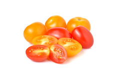 Cherry tomato and yellow plum tomato on white Royalty Free Stock Image