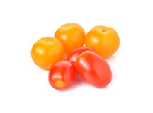 Cherry tomato and yellow plum tomato on white Royalty Free Stock Photo