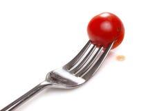 Cherry tomatoe on fork. Isolated on white background Stock Photography