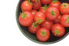 Cherry Tomatoes. Red ripe cherry tomatoes in a bowl on a white background Stock Photos