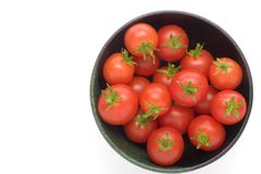 Cherry Tomatoes. Red ripe cherry tomatoes in a bowl on a white background Stock Image