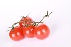 Cherry tomatoes. Red cherry tomatoes on a white background Royalty Free Stock Photo