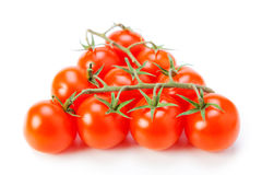 Cherry tomatoes. In a pyramid isolated on white background Stock Photos
