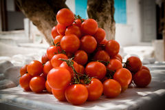 Cherry tomatoes. A heap of cherry tomatoes on the street Stock Images