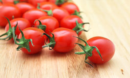 Cherry tomatoes. Closeup of cherry tomatoes on cutting board Royalty Free Stock Photos