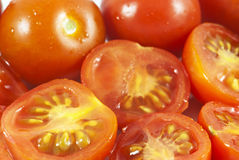 Cherry tomatoes. Whole and sliced cherry tomatoes Stock Photography