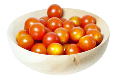 Cherry tomatoes. In the plate over white Stock Image