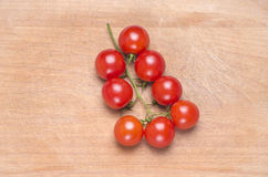 Cherry tomatoes. Red fresh cherry tomatoes on a used wood cuting board Stock Photography