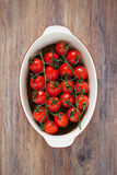 Cherry tomatoes. On branch baked in balsamic sauce, selective focus Stock Image