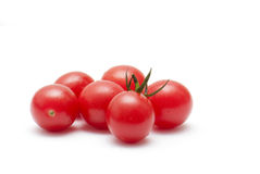 Cherry Tomatoes. Fresh ripe cherry tomatoes scattered isolated on white background Stock Image