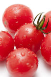 Cherry Tomatoes. Fresh ripe cherry tomatoes scattered isolated on white background Stock Photo