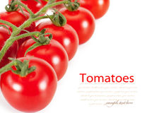 Cherry tomatoes. Isolated on a white background Royalty Free Stock Image