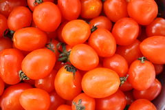 Cherry tomatoes. Organically grown red cherry tomatoes background Stock Images