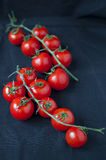 Cherry tomatoes. On black background Royalty Free Stock Photo