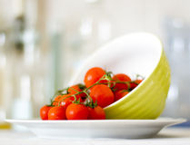 Cherry Tomatoes. Delicious cherry tomatoes on a plate in a kitchen Stock Photography