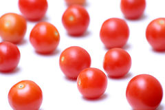 Cherry tomatoes. Randomly place cherry tomatoes on white background Stock Images