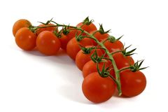 Cherry Tomatoes. Over white background royalty free stock photo