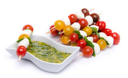 Cherry Tomatoes And Mozzarella On Skewers And A Vinaigrette Sauce With Basil Stock Photo