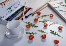 Cherry tomatoes ans arugula Stock Images