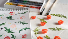 Cherry tomatoes ans arugula Stock Photo