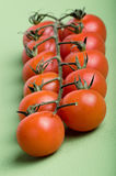 Cherry tomatoes attached on green vines Royalty Free Stock Photography