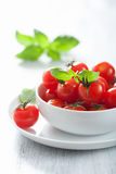 Cherry tomatoes and basil in bowl Royalty Free Stock Photos