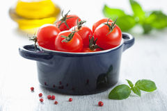 Cherry tomatoes and basil in casserole Stock Photography