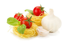 Cherry tomatoes, basil, garlic and pasta Royalty Free Stock Photography