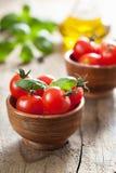 Cherry tomatoes and basil Stock Photo