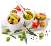 Cherry tomatoes, basil leaves, mozzarella cheese, olives and oli Stock Photos