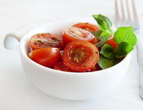 Cherry Tomatoes and Basil Stock Images