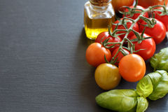 Cherry tomatoes, basil and olive oil o Stock Photo