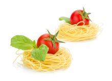Cherry tomatoes, basil and pasta Stock Photo