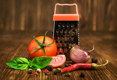 Cherry tomatoes with basil, spices and small grater Stock Image