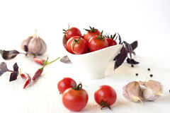 Cherry tomatoes and basil Royalty Free Stock Image