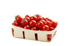Cherry tomatoes in basket isolated Stock Images