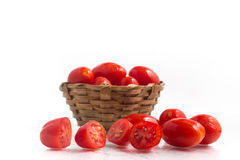 Cherry Tomatoes into a basket Stock Images