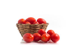 Cherry Tomatoes into a basket Stock Photo
