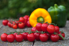 Cherry tomatoes and bell peppers Royalty Free Stock Image