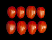 Cherry tomatoes  on a black background Royalty Free Stock Images