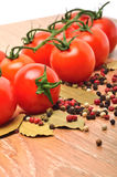 Cherry tomatoes with black pepper and bay leaf Royalty Free Stock Photo