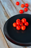 Cherry tomatoes in a black plate Royalty Free Stock Photos